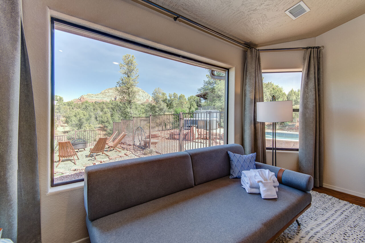 Master Bedroom with a Twin Day Bed and Large Window Overlooking the Backyard and Red Rock Vistas
