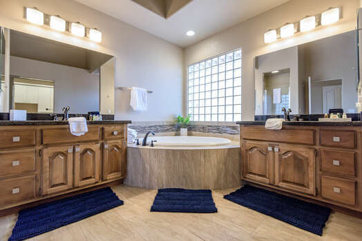 Private Master Bath with Separate Vanities and a Large Soaking Tub