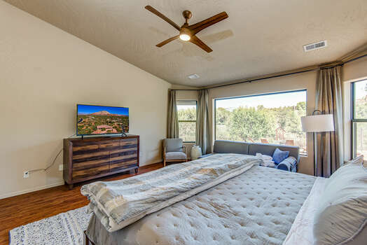 Spacious Master Bedroom with a King Bed and Gorgeous Hardwood Flooring