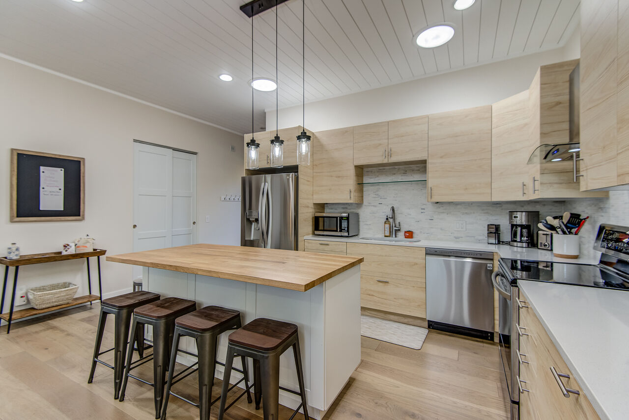 A Chef's Kitchen with a Center Island and Seating for Four