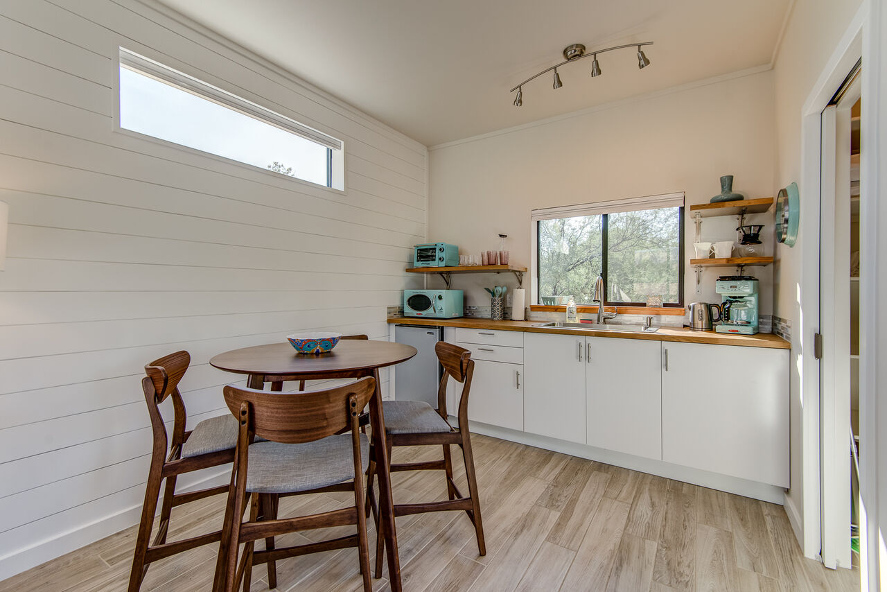 Dining Table with Seating for Four and Kitchenette with a Mini Fridge, Microwave, Toaster Oven and Coffee Maker