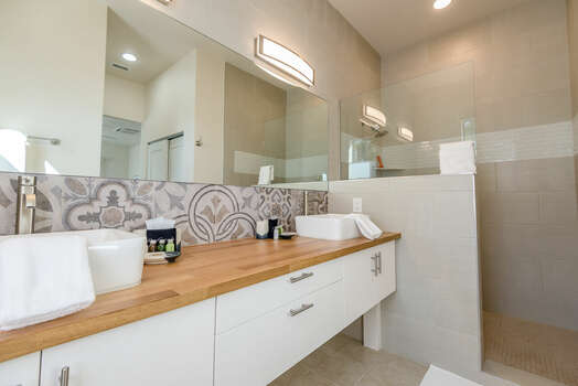 Dual Sinks and a Walk-in Tile and Glass Shower