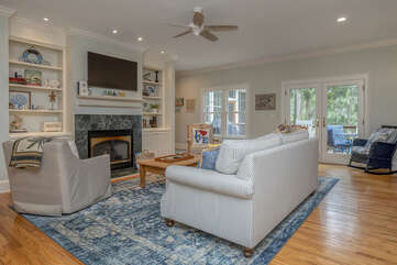 Family room with ample seating.  French doors to back deck.