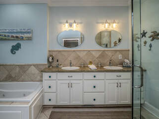 Twin sinks, glass shower and jacuzzi tub
