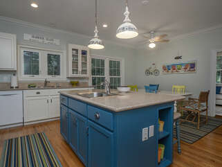 Kitchen island with sink and extra seating.