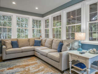 Sun room with views of flora and fauna with plenty of seating.
