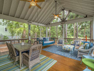 Fantastic screened porch plenty of space to relax, play games or read .