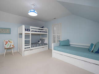 2nd floor guest bedroom with twin bunk bedsw/ trundle + twin w/ trundle - sleeps 5