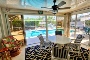 Glassed in patio with sliding door that open up onto the screened in lanai with pool
