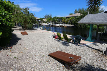 Back yard games and seating with canal views