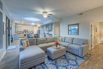 The great room floor plan is open and spacious with plush furnishings.