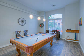 The pool table in the game room  invites friendly competition among guests.