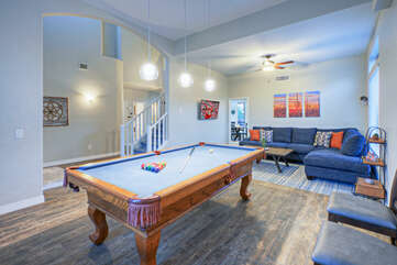 The plush seating in the game room is the ideal spot to cheer for your favorite pool shark.