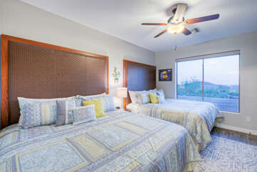 The second bedroom is upstairs and features 2 king beds, a walk-in closet, TV, ceiling fan and private bath.