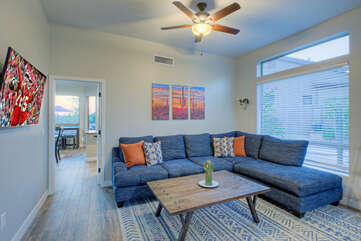 Game room provides a comfortable place to relax in front of the large smart TV.