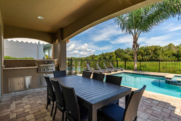 Dine al fresco with seating up to 8 guests and grill up lunch for the family in the summer kitchen.