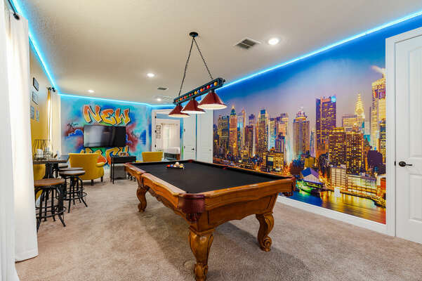 Play a round of pool with friends or family in the custom NY themed loft.