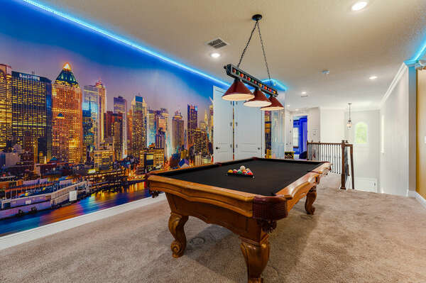 Admire the 30-ft NYC sunset skyline  during a game of pool