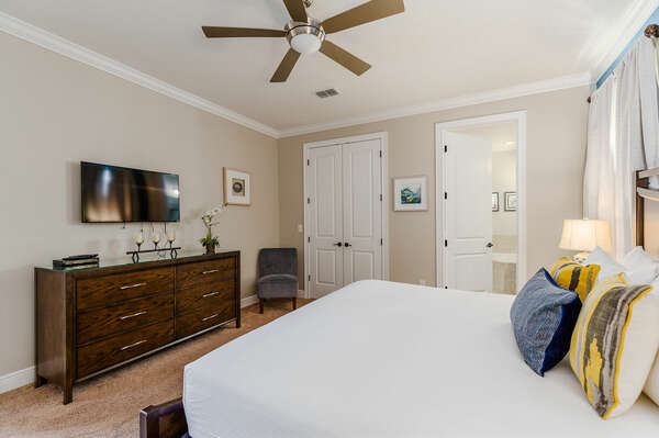 Spacious bedroom with a ceiling fan for optimal comfort