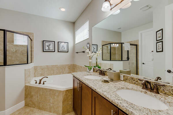 Get ready in the ensuite bath with a dual vanity, walk-in shower and garden tub