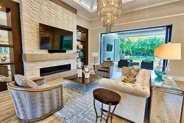 Great room- open to dining, kitchen and lanai/pool.