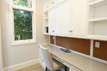 Built in office adjacent to the kitchen and butler's pantry.