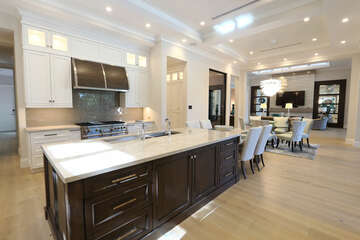 Open gourmet  kitchen with island and gas stove.  Upgrades galore!