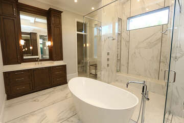Master bathroom - his and her closets and vanities.