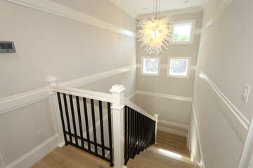 Stair to second level with two ensuite bedrooms, coffee bar and washer/dryer.