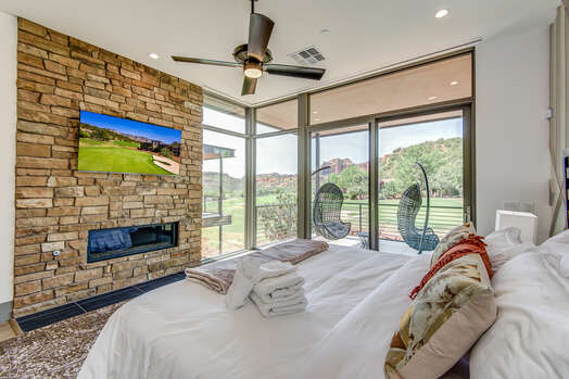 Master Bedroom with a King Bed, Gas Fireplace and a Smart TV