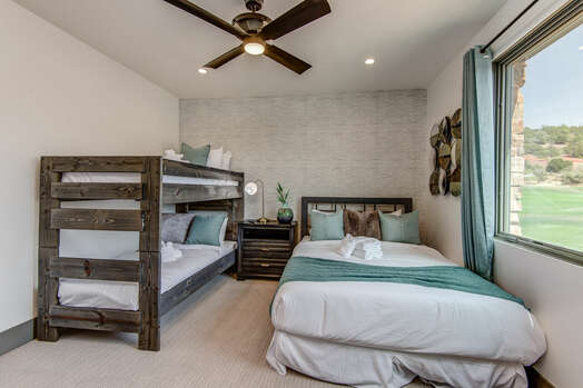 Bedroom 3 with a Queen Bed and Twin over Twin Bunk Beds