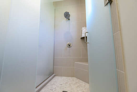 Full Shared Bath with a Tile and Frosted Glass Shower