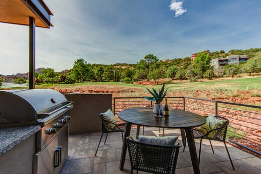 Outdoor Dining Area with a Gas BBQ Grill and Stunning Views