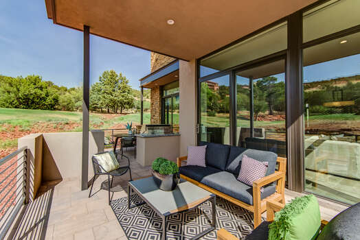 Enjoy Your Morning Coffee or Evening Cocktail on the Patio with Comfortable Furnishings