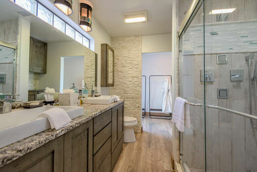 En Suite Bath with Dual Sinks and a Tile/Glass Shower
