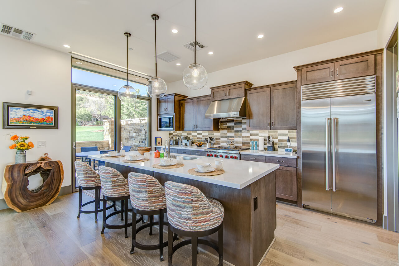 Gourmet Kitchen with a Large Center Island and Seating for Four