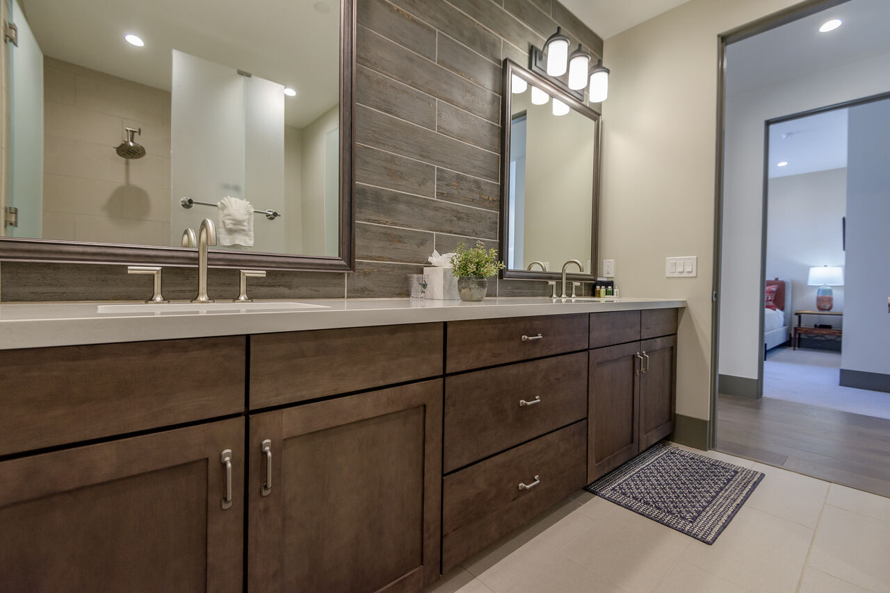 Upper Level Full Shared Bath with Dual Stone Counter Sinks