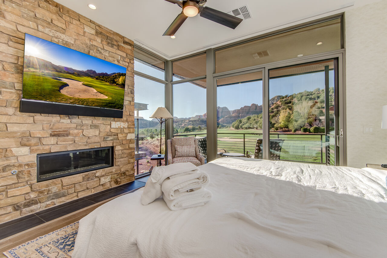 Master Bedroom with a King Bed and Plenty of Natural Light and Stunning Views