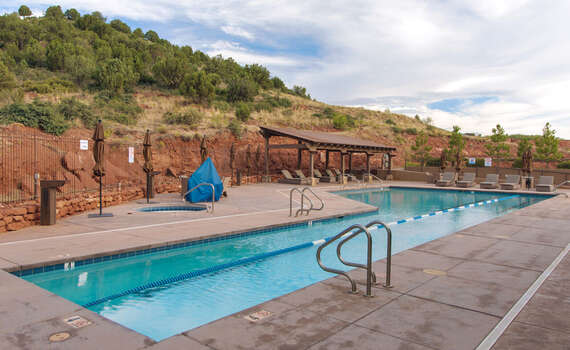 Seven Canyons Community Heated Pool Open Year-round with Lounge Chairs and Views