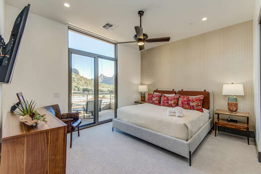 Bedroom 2 with a King Bed and Access to a Private Balcony