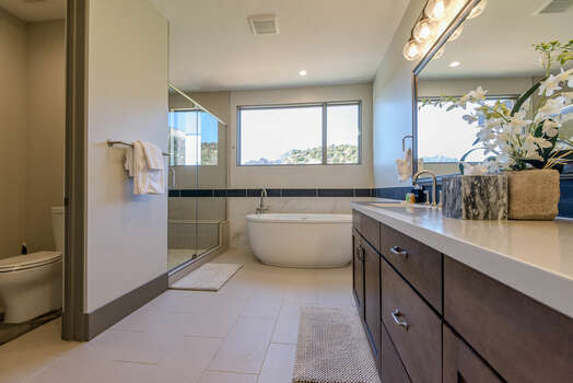 Master Bath with a Water Closet, Soaking Tub and Plenty of Natural Light and Views