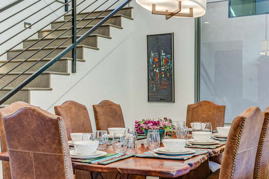 Love Wood Dining Table and Comfortable Leather Chairs