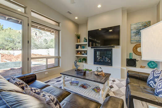 Comfortable Furnishings Surround a Gas Fireplace and a 75