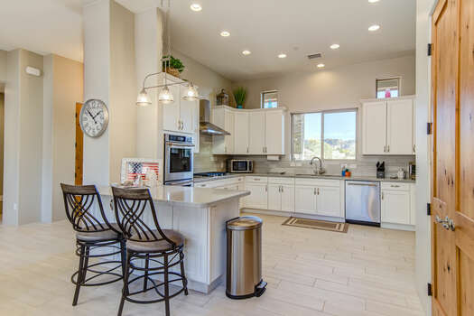 Fully Equipped Kitchen with Stone Counters and Bar Seating