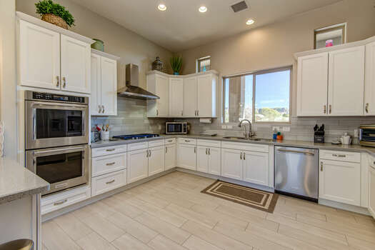 Offering Stainless Steel Appliances Including a Gas Stovetop and Double Convection Ovens
