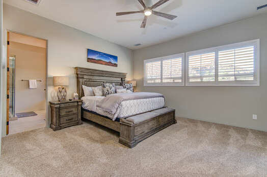 Master Bedroom with a King Bed with Plenty of Natural Light
