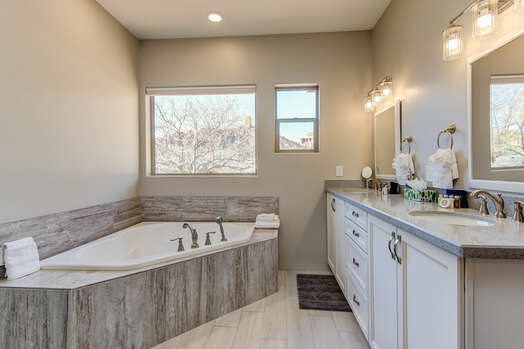 Master Bath with Dual Stone Counter Sinks, a Large Soaking Tub and Red Rock Views