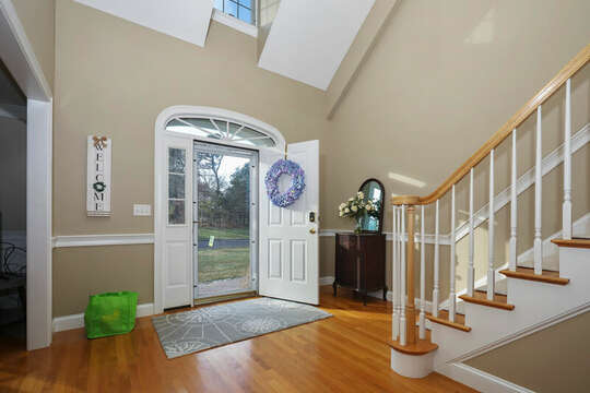 Two story entry way with stairs to upper level - 1 Somerset Road Harwich Cape Cod - New England Vacation Rentals