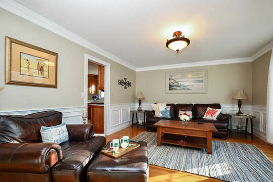 Den off of entryway with cool leather couch and chair - TV for viewing - 1 Somerset Road Harwich Cape Cod - New England Vacation Rentals