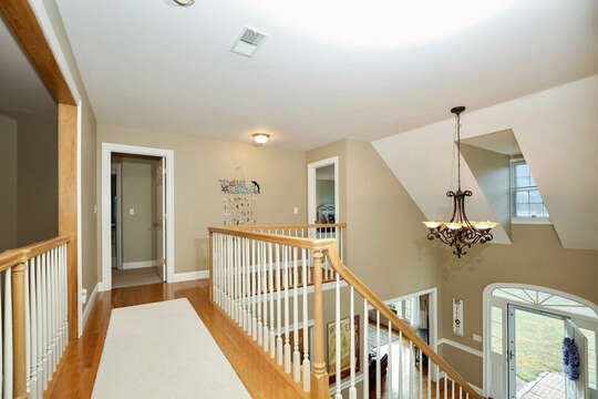 Balcony on upper level overlooking great room and entry way - 1 Somerset Road Harwich Cape Cod - New England Vacation Rentals